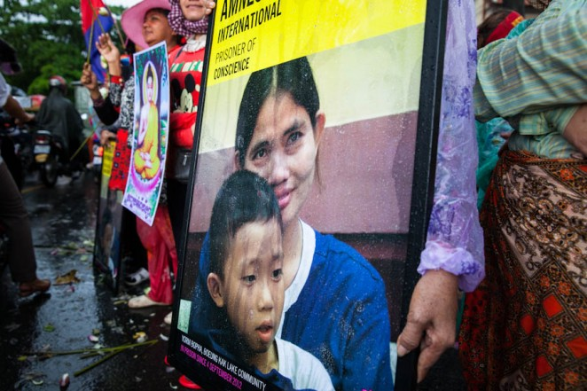 A poster of Amnesty International's prisoner of conscience Yorm Bopha and her son. ©Erika Pineros