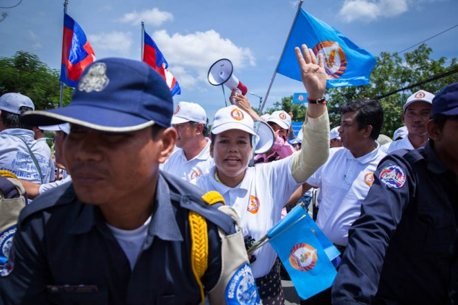 Ruling party CPP supporters at a rally close to Prime Minister Hun Sen's house, while Boeung Kak villagers clash with the police nearby. Jul. 02, 2013. ©Erika Pineros