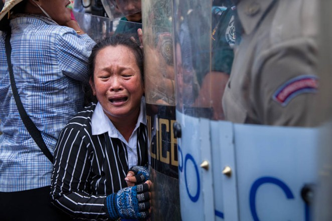 A Boeung Kak demonstrator cries during clashes with the police. Jul. 02, 2013. ©Erika Pineros