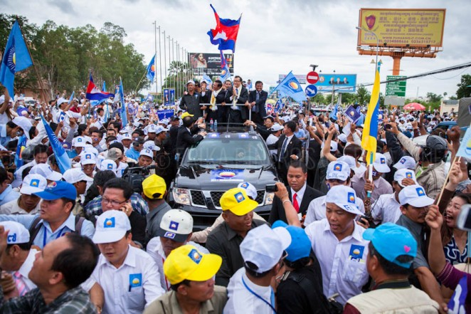 Cambodian opposition leaders Kem Sokha and Sam Rainsy greet supporters during Sam Rainsy's return from self-imposed exile to Cambodia. Jul. 19, 2013 ©Erika Pineros