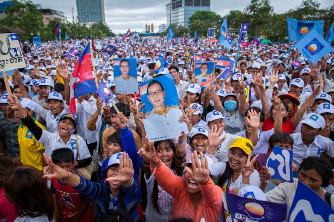 An estimated 100,000 supporters welcomed CNRP's Sam Rainsy on his return from self-imposed exile to Cambodia. Jul. 19, 2013 ©Erika Pineros