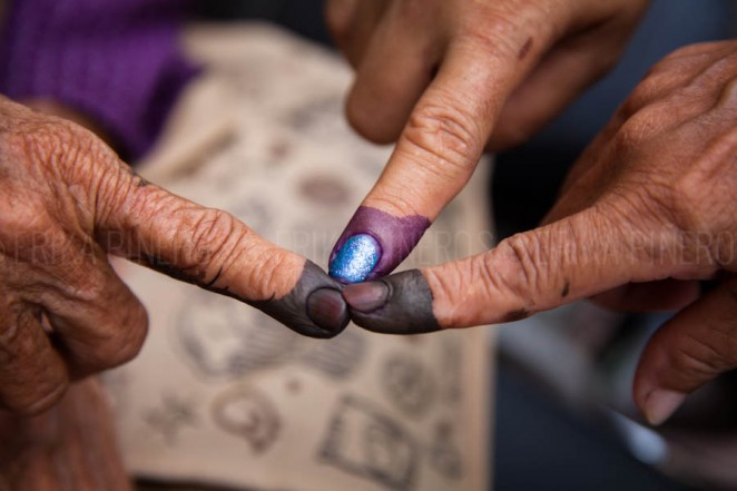 Different kinds of 'indelible'  ink were used at different voting stations. Voters complained the purple ink came off easily after washing it off. Jul. 28, 2013 ©Erika Pineros