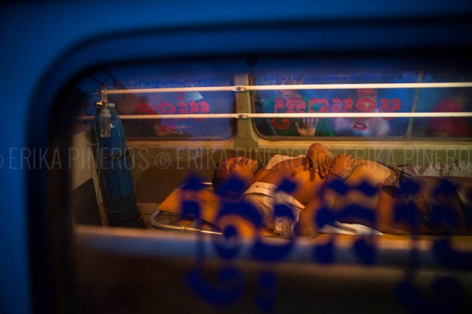 A man lays in an ambulance after being attacked by mob in Phnom Penh's Stung Meanchey district when he was mistaken to be Vietnamese. Jul. 28, 2013 ©Erika Pineros