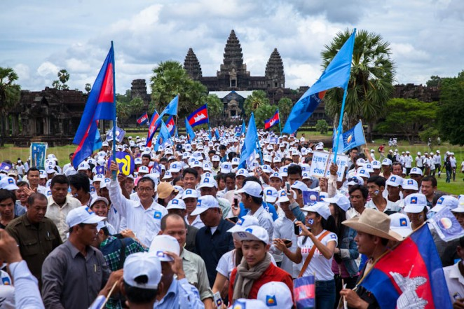 Cambodia National Rescue Party supporters walk along opposition leader Sam Rainsy in Angkor Wat, Siem Reap. Jul. 24, 2013 ©Erika Pineros