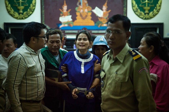 Yorm Bopha cries as she leaves the Appeal Court after being sentenced to two years in prison. Phnom Penh, Cambodia. Jun. 14, 2013 ©Erika Pineros