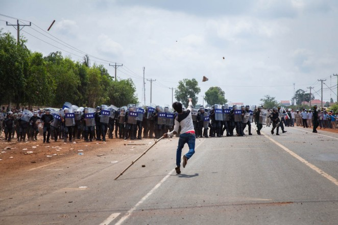 Demonstrators throw sticks and rocks to the police during the clash in front of Sabrina Factory. Workers have been on strike since May 25, 2013 demanding a salary increase. Kampong Speu, Cambodia. Jun. 03, 2013. ©Erika Pineros