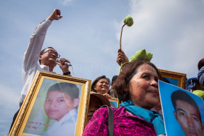 Accompanied by families of January's deadly clashes victims opposition leader Sam Rainsy addresses the crowds in front of Freedom Park. May 1, 2014 ©Erika Pineros