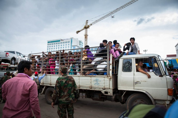 Thousands of workers are driven in Thai trucks to the Cambodian border town of Poipet. June 17, 2014. Cambodia ©Erika Pineros