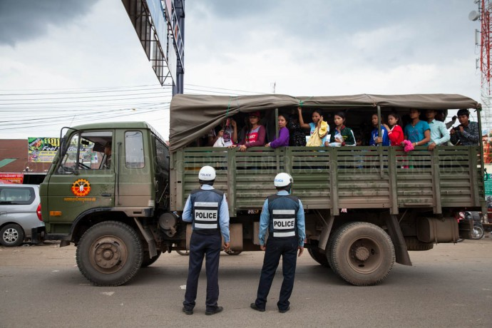 Workers and their families returning from Thailand are transported in army trucks back to their provinces in Cambodia. June 17, 2014. Cambodia ©Erika Pineros