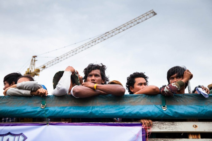 Cambodian workers arrive in trucks from Thailand to Poipet. Everyday, thousands continue to return to Cambodia fleeing the Thai Coup. June 17, 2014. Cambodia ©Erika Pineros