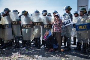 Mother of landrights activist Bopha, cries in front of police barricade after finding out Bopha was sentenced to three years in jail.