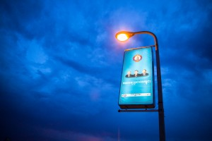A poster of the ruling Cambodian People's Party (CPP) can be seen lit by a lamp post at the Japanese bridge in Phnom Penh.