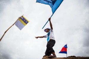 A CNRP supporter waves a flag during opposition leader Sam Rainsy's return to Cambodia.