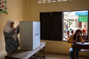 A Muslim woman casts her vote at her local Mosque on the outskirts of Phnom Penh.