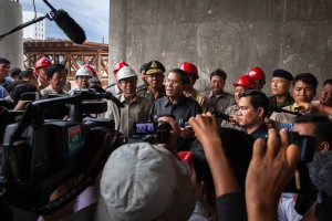 Prime Minister Hun Sen addresses the media during his visit to Stung Meanchey's bridge on his first appearance after elections. Phnom Penh.