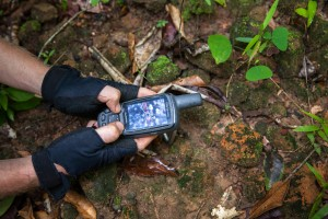 Using a GPS unit, the ADF team compares the findings with the LIDAR data during a ground check expedition. Siem Reap Province, Cambodia.