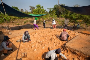 A group of workers carefully remove dust to uncover what could have been the basis of a Pre-Angkorian temple during an excavation at Phnom Kulen by the ADF team. Siem Reap Province, Cambodia.