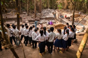 Students from a local village get a private tour of an excavation site. As part of its education program, the Archaeology & Development Foundation (ADF) invites local schools to visit the excavation sites encouraging new generations to preserve their heritage. Siem Reap Province, Cambodia.