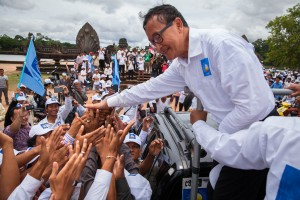 Opposition leader Sam Rainsy salutes supporters in front of Angkor Wat, Siem Reap.