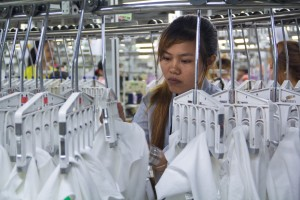 A factory worker inspects the garments. Cambodia's garment sector employs more than 650,000 people, it was worth more than US$5bn in exports in 2013, and accounts for 80 percent of the country's exports.
