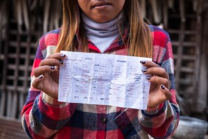 """We work under poor conditions, but we don't want to leave because other factories are too far."" A factory worker shows her payslip. For weeks, workers demanded a $5/month salary increase."