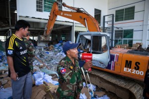 Cambodian armed forces clear the area in precaution for any further collapsing in Wing Star Factory, which collapsed killing two.