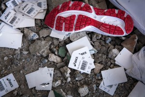 Wing Star shoe factory sources Japanese brand Asics. Shoe soles and tags are seeing on the rubble after a building collapsed killing two.