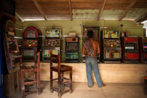 A man gambles at the local casino in Frasquillo, Córdoba, a region where coca plantations increased by 146% in 2016. In many of Colombia's most remote areas, the coca business fuels almost the entire local economy.