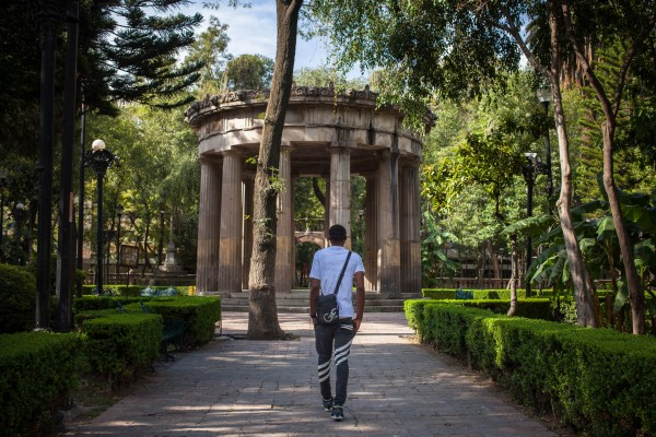 Victor walks through a park near the shelter where he has stayed since his arrival in Mexico City. He says he wants to stay in Mexico, learn Spanish, and study.