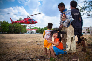 In 2015 a Cambodian and international team embarked on the most extensive archaeological LIDAR mission to date. Children from nearby villages who came to witness the unusual sight at Kampong Thom's Army Base, react with astonishment and fear as the LIDAR helicopter takes off.