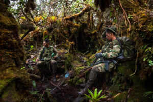 Ground Combat Battalion soldiers take a break during a massive field search for 51 year-old teacher Rosalba Ariza who was kidnapped by men wearing identifying armbands of Colombia's rebel group The National Liberation Army's (ELN) on November 1, 2016. Loaded with more than 50 pounds of equipment and ammunition, the soldiers struggled to catch their breath hiking at more than 3,500 metres of altitude in the Andes' highlands of Colombia.